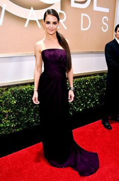 Katie Holmes wearing a Marchesa aubergine draped strapless gown at the 72nd Annual Golden Globes