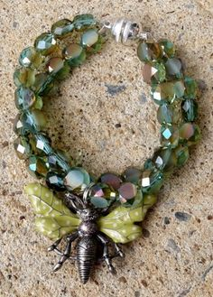 Aurora Borealis Sage Green Crystal Butterfly Charm Bracelet measures 6.50 inches for small  wrists.  Double strand AB Sage Green crystals, 13x5mm, multifaceted.  Double sided enamel charm of butterfly