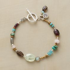 """JUXTAPOSE BRACELET--Faceted and smooth, big and small, semiprecious gems—turquoise, labradorite, garnet and quartz—juxtapose beautifully in this handcrafted bracelet. Sterling silver toggle clasp. USA. Exclusive. 7-1/2""""L."""
