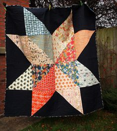Giant star tutoriall--from Jeni's blog link--really like this--guess the black background just makes the other scrappy fabric pop