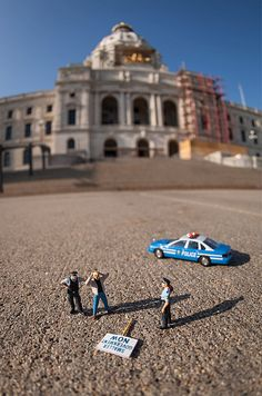 HO scale figures in front of real life backgrounds. $45