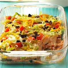 Creamy Taco Dip Recipe -You'll know this snack is a hit at your next gathering when you come home with an empty pan! —Denise Smith, Lusk, Wyoming