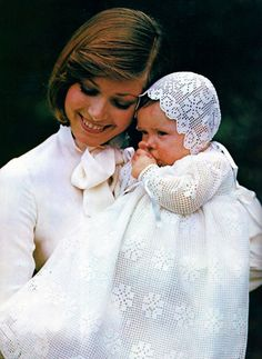 Beautiful heirloom christening gown with matching bonnet is worked in delicate filet crochet. Narrow ribbins close the gown in back and make ties