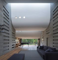 Skylights fill the spaces between the ground floor ceiling, allowing daylight to reach the living room, and the adjoining kitchen and dining...