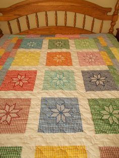 Beautiful cot quilt made with chicken scratch embroidered blocks.
