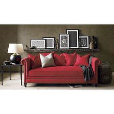 Love the shelf with picture frames above the couch