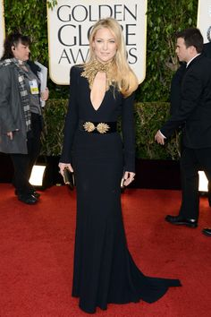 Kate Hudson flaunts a dramatic Alexander McQueen outfit at the 70th Annual Golden Globe Awards