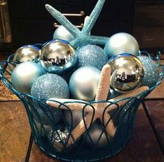 Christmas balls bowl - what a pretty centerpiece that would make.  change colors and have like feathers instead of shells