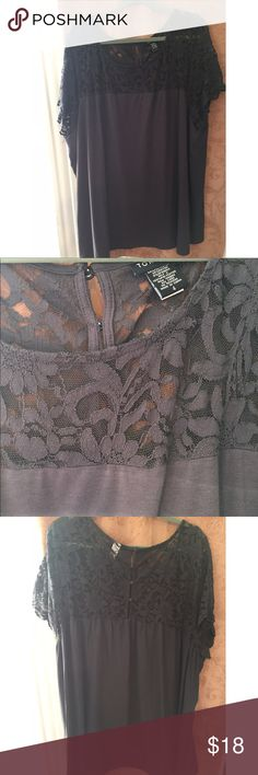 Torrid laced design top Worn twice. Very flattering. Great color. Love the lace design. Buttons on the back. Great for work or going out. Feel free to ask questions torrid Tops