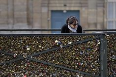 Paris to break hearts with removal of a million 'love locks' from the Pont des Arts