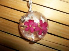 Real red flowers in resin and wire wrapped necklace pendant   Seasonal Remedies