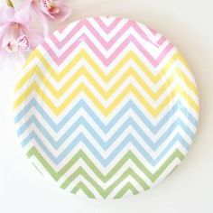"Pastel Chevron Large Paper Plates - These gorgeous chevron party plates are sure to delight!  They are the perfect addition to your Easter table this year.  Each pack contains 12 round party plates made of high quality thick stock.  Dimensions: 23 cm diameter (9"")"