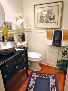 Asian Inspired Powder Room: The art inspiration for this look, was a beautiful Asian block print that belonged to my Mother-in-Law. The gold, black and gray were a great color combination to pull from the print.