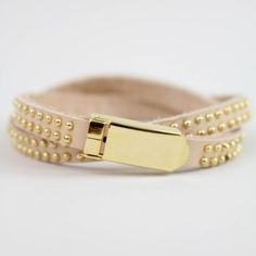 """As seen on ShopDesignSpark.com  -faux leather wrap with gold detail  -3""""W, 2-hole buckle  -imported"""