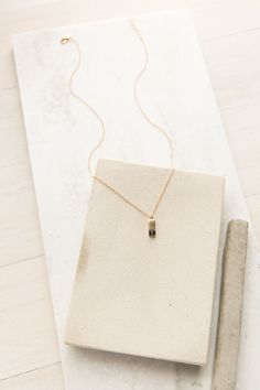 Take A Number Marble Necklace in Gold + Black