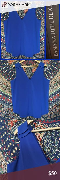 NEW! Banana Republic Royal Blue Office Top Large • Name brand: Banana Republic • Condition: New Without Tags! Never Worn! Flawless! • Size: Large • Style # V306006 SL CREPE VEE T SURF THE WEB • Color: Royal Blue • Details: Sleeveless, V neck, breath-taking beautiful! • A Must-Need to your closet!  • Perfect for summer & fall Office Career fashion! Banana Republic Tops Blouses