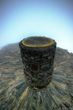 Yr Wyddfa Summit - Mount Snowden. -   the highest mountain in Wales, at an altitude of 1,085 metres (3,560 ft) above sea level, and the highest point in the British Isles outside Scotland. It is located in Snowdonia National Park (Parc Cenedlaethol Eryri) in Gwynedd. - Keith Flamée.