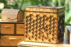 Unique box featuring an intricate honeycomb and bees - precision lasercut and varnished to a beautiful golden finish.