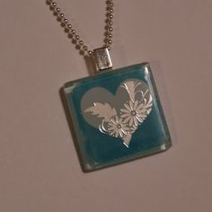 DIY Tutorial Glass Tile Pendants. And they are so inexpensive