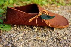 Soccasins! More of an *indoor slipper or sock (Hence, the name Soccasin) than a durable outdoor moccasin. Our unique Soccasins are weightless, comfortable, simple, and so comfortable to wear! Slide right in to this below-ankle slip-on moccasin and enjoy! Each Soccasin is made from one piece of soft and supple leather, folded over and sewn to snugly fit your foot. Theyre so close to being barefoot you wont even notice you have them on! Adorning every one of them is a signature Tread Light…