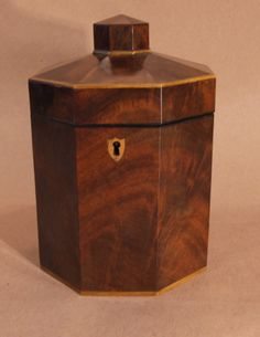 "Octagonal Tea Caddy, England, Circa 1780, George III mahogany and boxwood tea caddy of octagonal pillar box form, having shield inlaid escutcheon and retaining old finish 9""H x 5""W from Yew Tree House Antiques/1st Dibs"