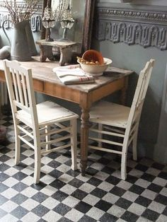 tiles, table and chairs, moulding on wall, such a beautiful look!