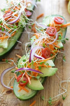Cucumbers with the seeds scooped out and filled with hummus, avocado, tomatoes, onion and sprouts. So refreshing, healthy and light!
