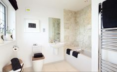 Redrow Homes - interior designed bathroom with beautiful tile work with charcoal / black accents.