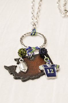A fun original design - Seattle Seahawks-inspired pendant on an 18 chain.