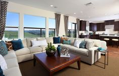 Colina Plan 3 Living Room by SheaHomesNoCal | Teal and Brown Decor #livingroom