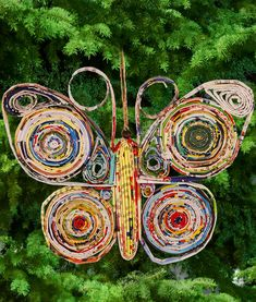 Recycled Magazine Butterfly Ornament at The Animal Rescue Site  I like it as a decor item, not an ornament  ONLY $3.00!
