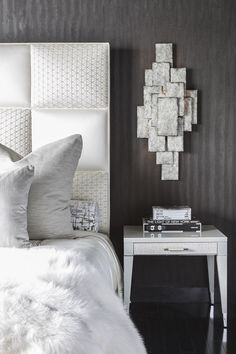 All About Texture: These Porta Romana Sconces add depth and an architectural element above the Fendi Casa night table, and pop against the Roberto Cavalli wallpaper.
