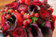 Black Baccara roses, red hypericum berry, burgandy ranunculus, schwarzwalder mini calla lilies, red tulips - wedding flowers
