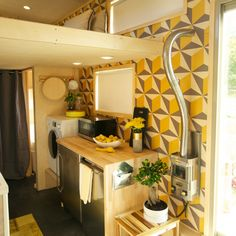 tiny house loft note bed built into the floor and look close at the floor thatu0027s a desk that swings up for use but is stowed away when not usingu2026 - Tiny House Appliances