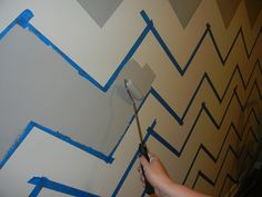 chevron wall - I would love to pair simple furniture with more complex wall textures and designs as compared to complex furniture arrangements and plain jane walls and colors.