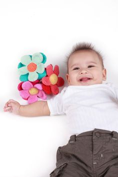 Pebble Baby playing with the Flower rattles- cute!