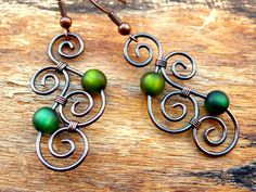 Earrings - Aotearoa - Copper & Polarisbeads GREEN - New Zealand Maori Symbols plafully wrapped out of oxidized copper wire. €16.50, via Etsy.