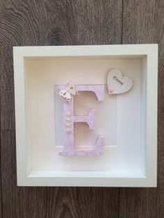 Hand painted and decorated letter framed.