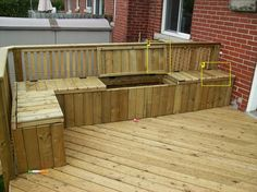 DIY deck with benches and compartments.