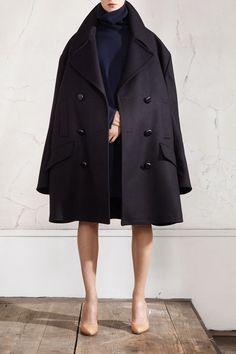 Maison Martin Margiela and H  Oversized peacoat, £149.99; oversized turtle neck jumper, £79.99; plexi wedge pumps, £149.99