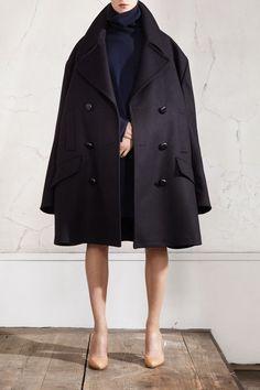 Maison Martin Margiela and H  Oversized peacoat, £149.99; oversized turtle neck jumper, £79.99; plexi wedge pumps, £149.99