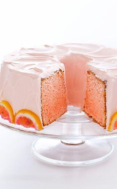 Pink Lemonade Cake: A tender chiffon cake with lemony cream cheese frosting and a pretty-in-pink hue. For a final touch, a ring of sugared lemon slices—pink, of course—circles the cake. Lemonade Cake Recipe, Pink Lemonade Cake, Just Desserts, Delicious Desserts, Dessert Recipes, Cupcake Recipes, Dessert Ideas, Chiffon Cake, Eat Dessert First