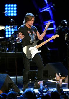 Keith Urban Photos Photos - Musician Keith Urban performs onstage during ACM Presents: Superstar Duets at Globe Life Park on April 18, 2015 in Arlington, Texas. - ACM Presents: Superstar Duets - Night 2 - Show