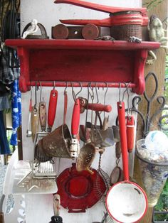 retro red vintage kitchen utensils hanging from a paper towel rack