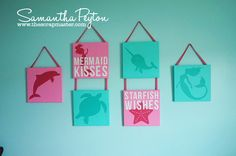 DIY Under the sea nursery wall decor **could also order small decals for the little canvases??**