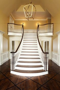wow - stunning staircase and hardwood floor design