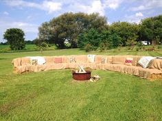 We brought in hay bales to arrange this seating area around the bonfire.  Complete with quilts and cute pillows.