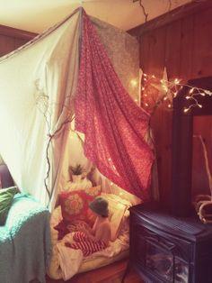 Willow branch indoor fairy-light pillow fort nook