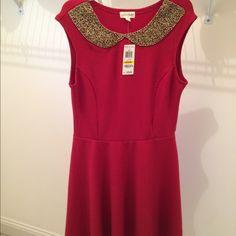 NWT's dress w/decorative neck Beautiful Red NWT's dress w/decorative neck. A-line Maison Jules Dresses