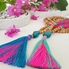 Tassel necklaces by Bright new Penny .. Long wooden bead + colored resin beads and pink and teal / turquoise tassels  https://www.etsy.com/shop/Brightnewpenny